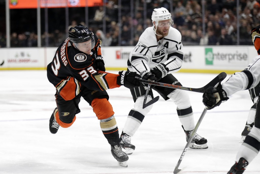 Anaheim Ducks' Jakob Silfverberg (33) shoots past Los Angeles Kings' Jeff Carter (77) during the second period of an NHL hockey game, Monday, Dec. 2, ...