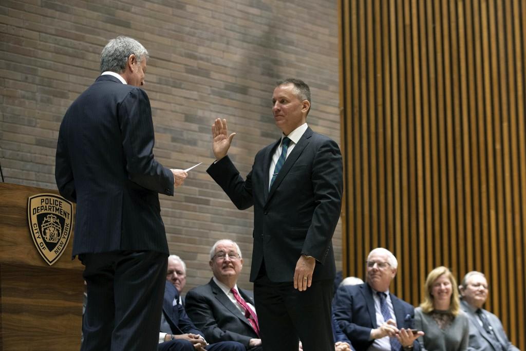 New York City Mayor Bill de Blasio, left, swears in incoming Police Commissioner Dermot Shea at police headquarters Monday, Dec. 2, 2019, in New York....