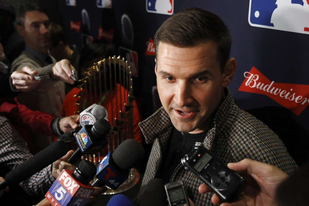 Washington Nationals first baseman Ryan Zimmerman speaks with members of the media as he arrives for the premiere of a documentary film on the team's ...
