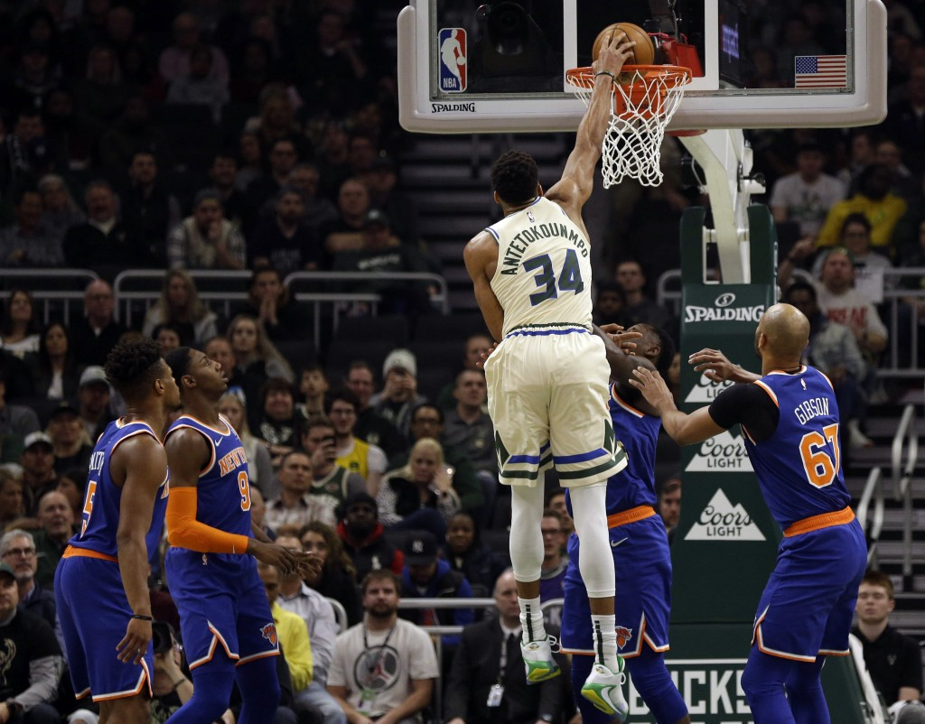 Milwaukee Bucks' Giannis Antetounmpo  (34) dunks against the New York Knicks during the first half of an NBA basketball game Monday, Dec. 2, 2019, in ...