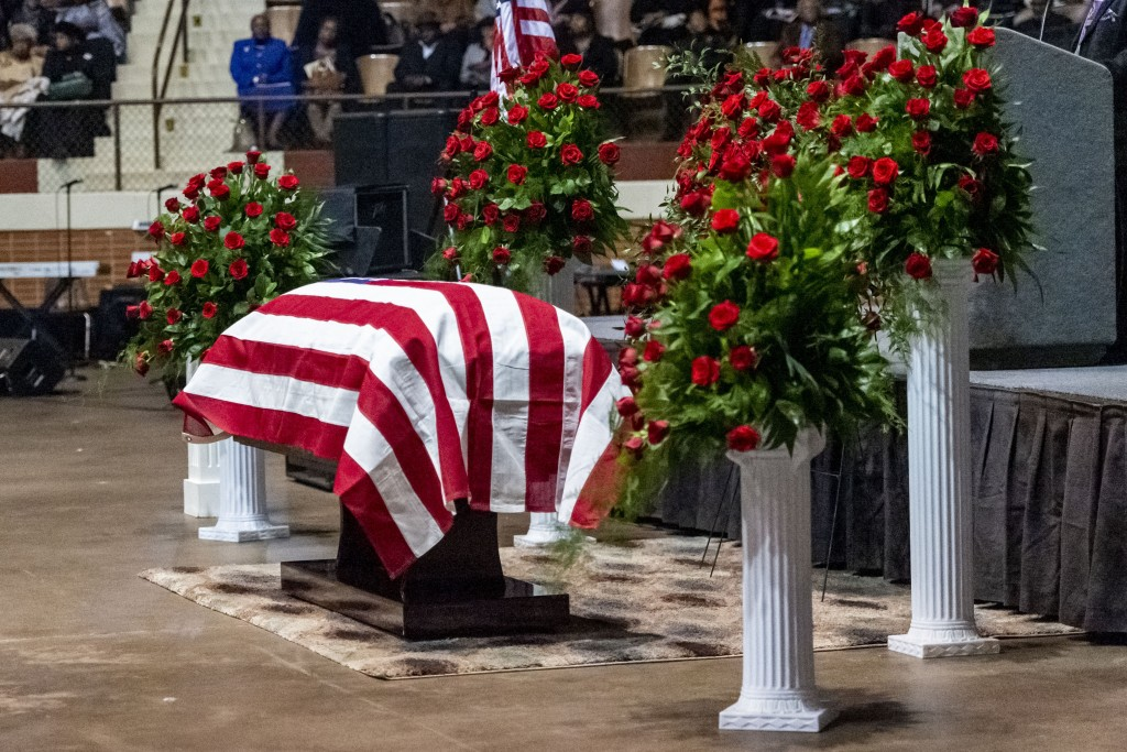 """The casket sits, under a U.S. Flag, flanked by rose bushes, during the memorial service for slain Lowndes County Sheriff """"Big John"""" Williams, Monday, ..."""