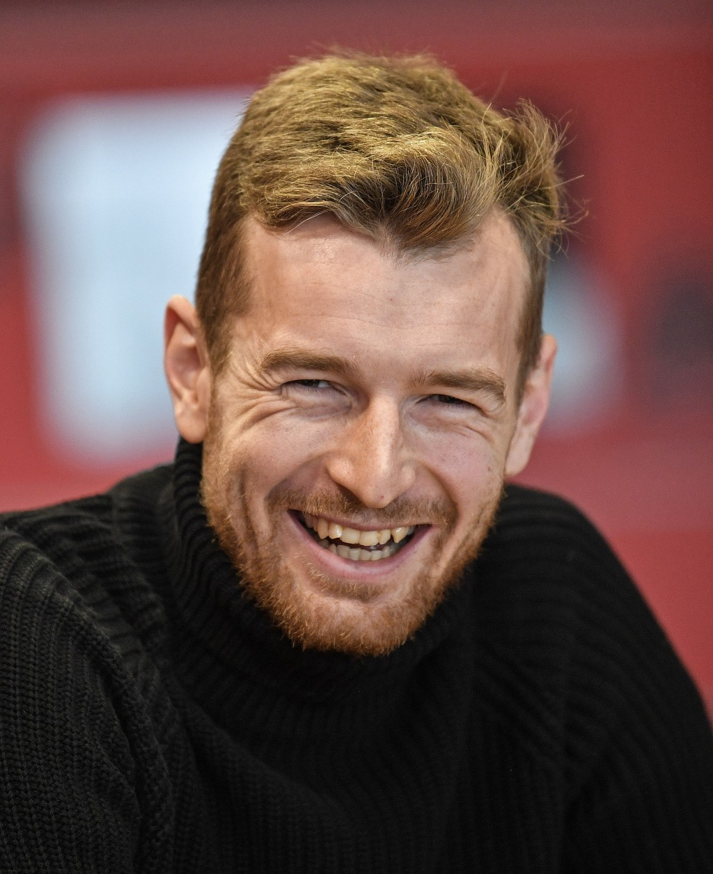 Leverkusen's goalkeeper Lukas Hradecky laughs during an interview with the Associated Press at the BayArena in Leverkusen, Germany, Monday, Dec. 2, 20...