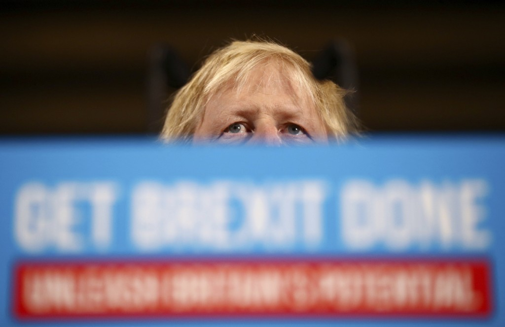 Britain's Prime Minister Boris Johnson attends a rally event as part of the General Election campaign, in Colchester, England, Monday, Dec. 2, 2019. B...
