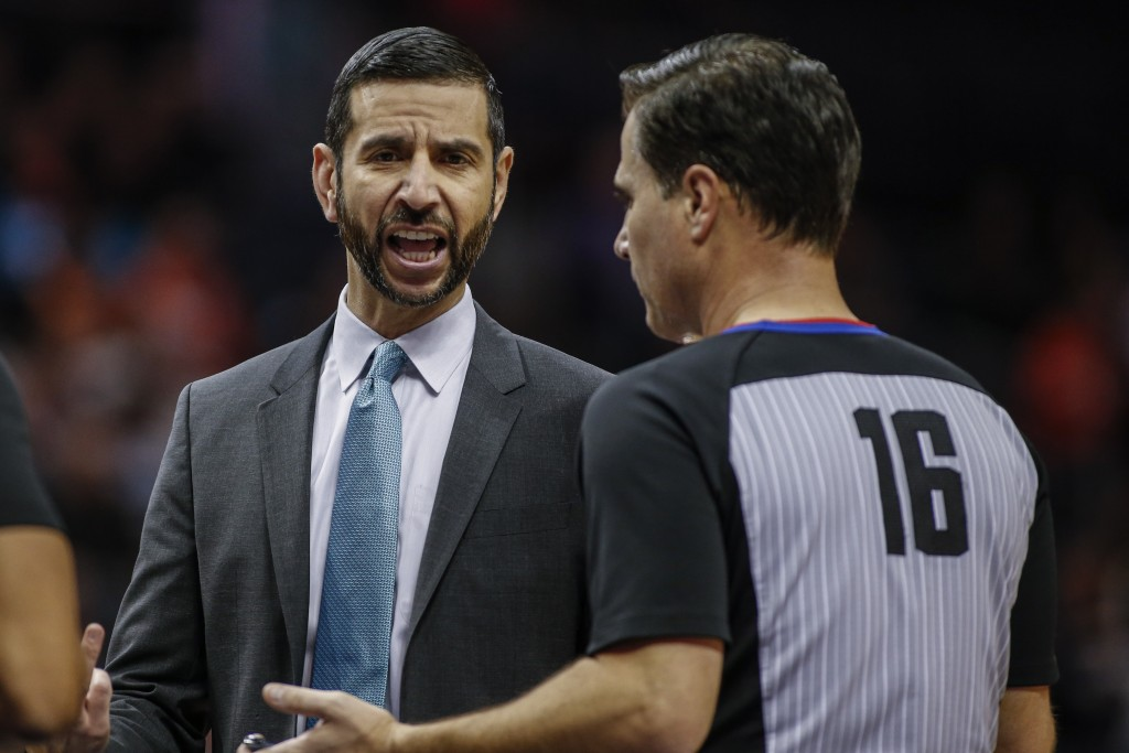 Charlotte Hornets coach James Borrego, left, argues with NBA official David Guthrie as the Hornets play the Phoenix Suns in the first half of an NBA b...