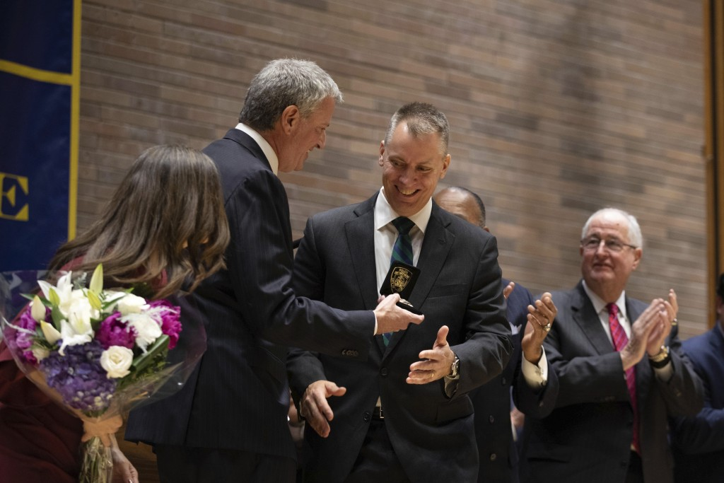 Mayor Bill de Blasio, second from left, presents the commissioner's badge to Police Commissioner Dermot Shea with at police headquarters Monday, Dec. ...