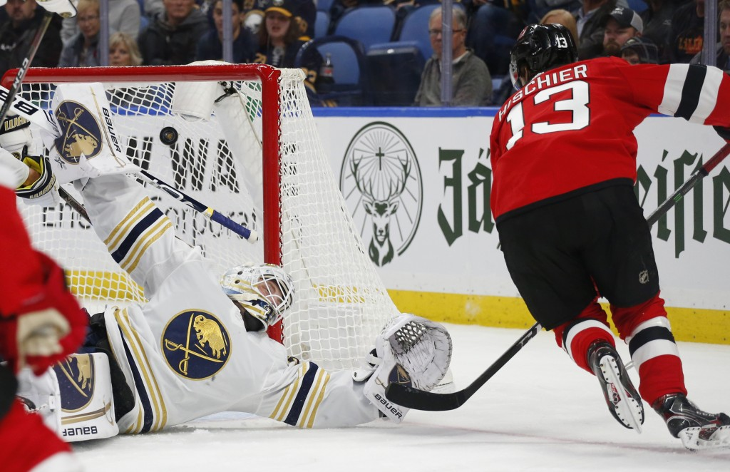 Buffalo Sabres goalie Linus Ullmark (35) is scored on by New Jersey Devils forward Nico Hischier (13) during the second period of an NHL hockey game M...