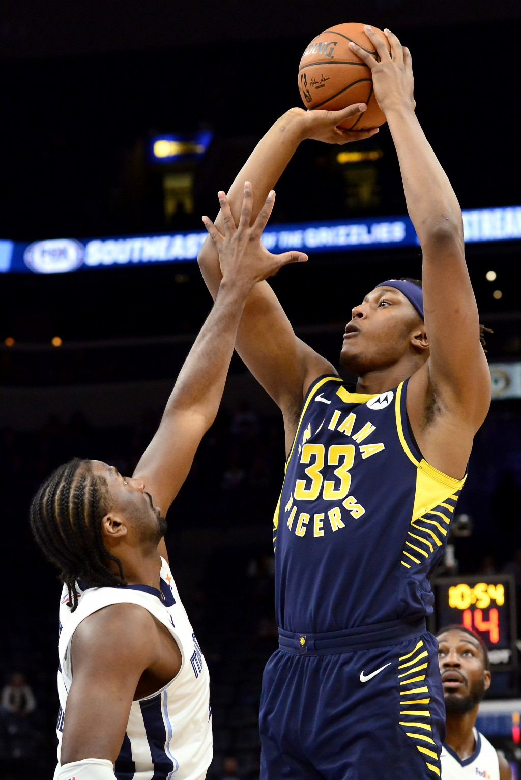 Indiana Pacers center Myles Turner (33) shoots against Memphis Grizzlies forward Solomon Hill, left, in the first half of an NBA basketball game Monda...