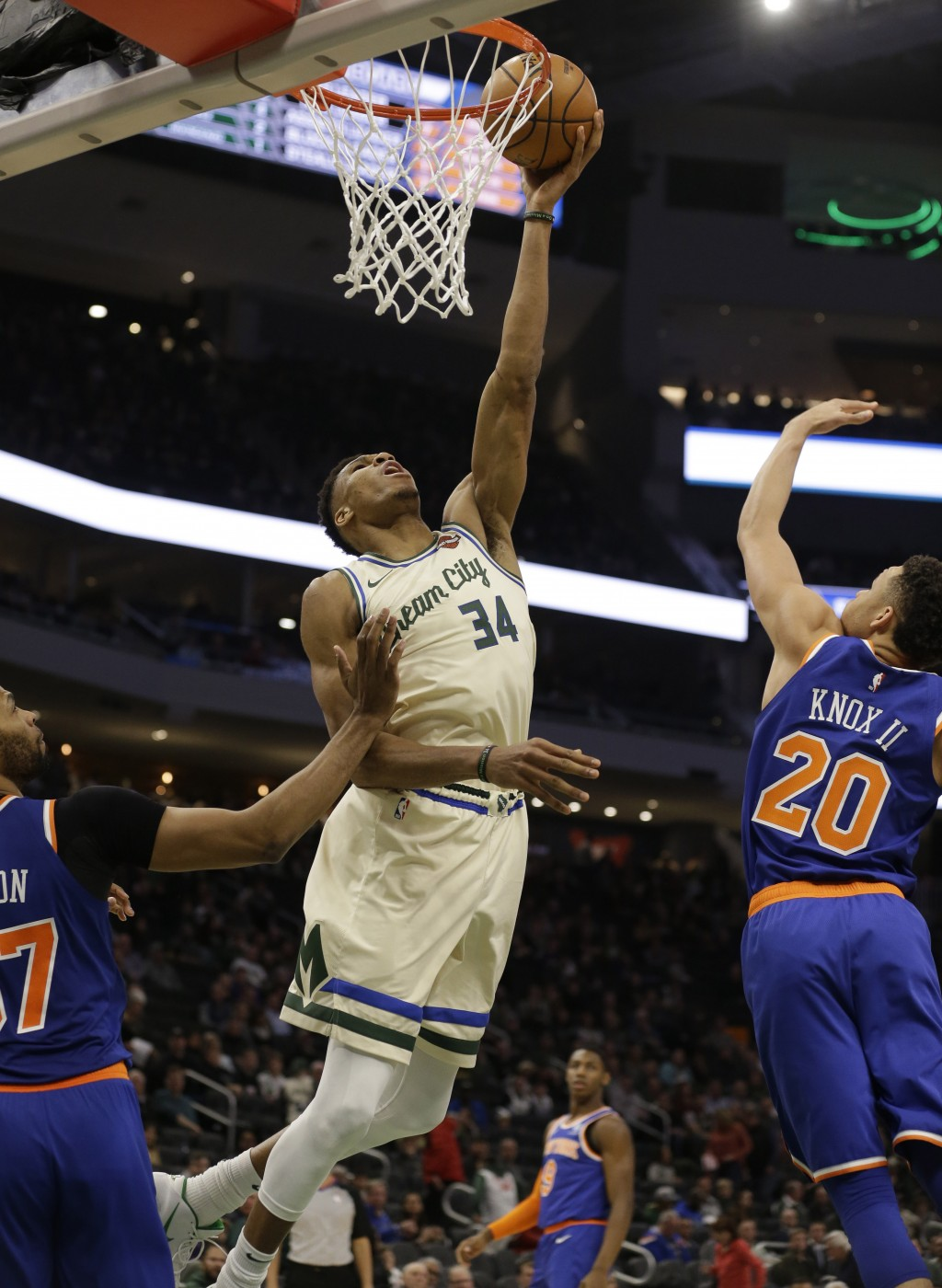 Milwaukee Bucks' Giannis Antetounmpo (34) shoots against the New York Knicks during the second half of an NBA basketball game Monday, Dec. 2, 2019, in...