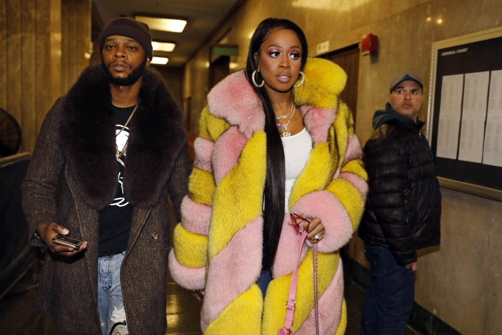 Rapper Remy Ma, whose real name is Reminisce Smith, leaves Manhattan criminal court, with husband Shamele Mackie, whose stage name is Papoose, in New ...
