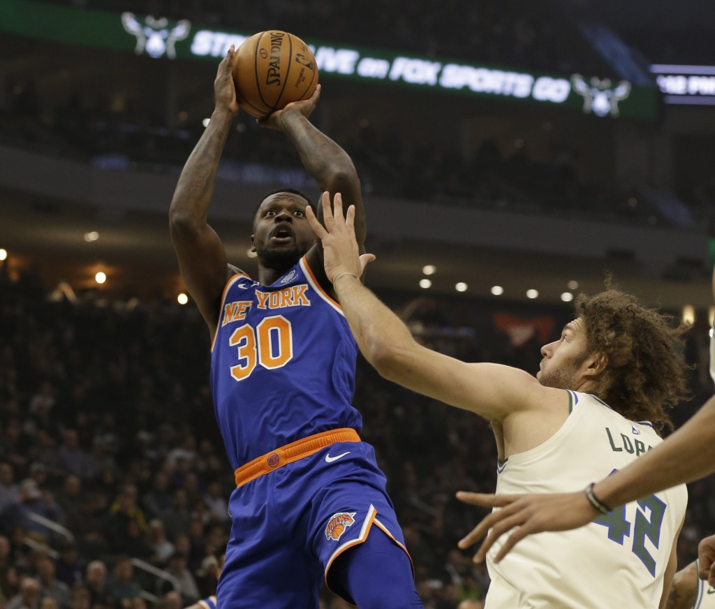 New York Knicks' Julius Randle (30) shoots against Milwaukee Bucks' Robin Lopez during the first half of an NBA basketball game Monday, Dec. 2, 2019, ...