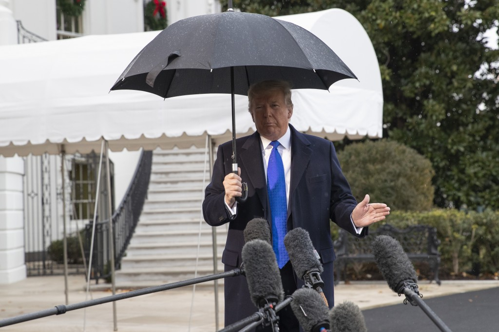 President Donald Trump speaks with reporters on the South Lawn of the White House before departing, Monday, Dec. 2, 2019, in Washington. (AP Photo/Ale...