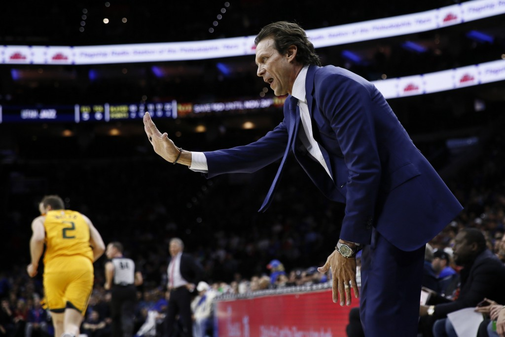 Utah Jazz head coach Quin Snyder reacts to a call during the first half of an NBA basketball game against the Philadelphia 76ers, Monday, Dec. 2, 2019...