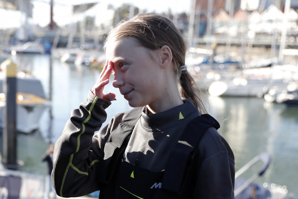 Climate activist Greta Thunberg gives an interview on the quayside in Lisbon, after arriving aboard the sailboat La Vagabonde, Tuesday, Dec 3, 2019. T...