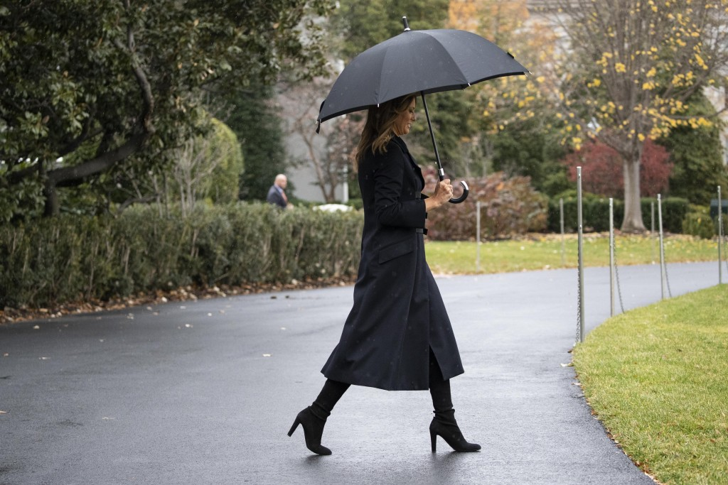 First lady Melania Trump walks on the South Lawn of the White House before departing with President Donald Trump as they head to England, Monday, Dec....