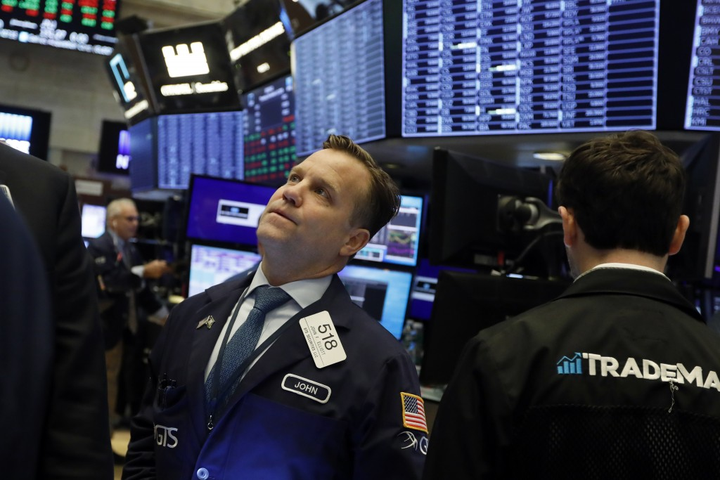 FILE - In this Nov. 14, 2019, file photo trader John Elliott works on the floor of the New York Stock Exchange. The U.S. stock market opens at 9:30 a....
