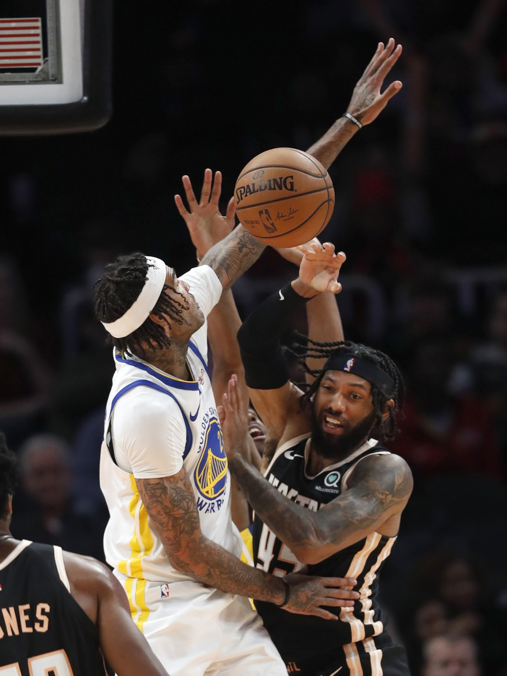 Atlanta Hawks guard DeAndre' Bembry (95) and Golden State Warriors center Willie Cauley-Stein (2) fight for a rebound in the second half of an NBA bas...