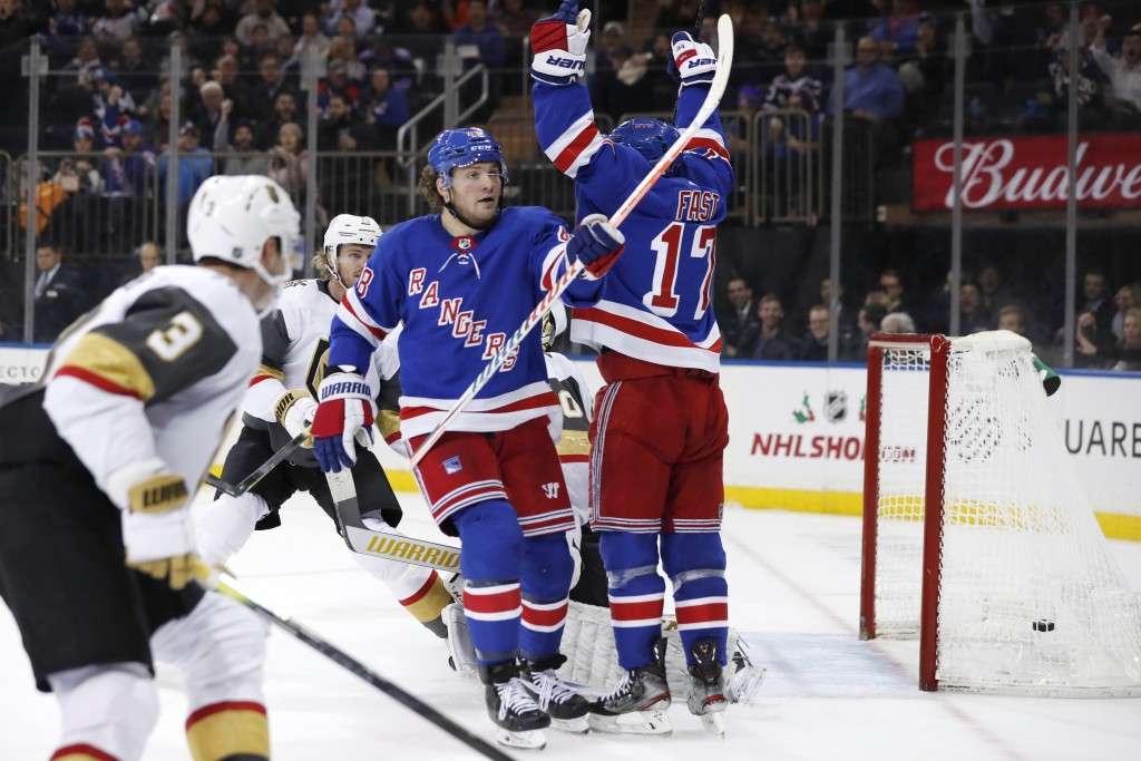 New York Rangers left wing Brendan Lemieux (48) and right wing Jesper Fast (17) celebrate Lemieux's goal during the second period of an NHL hockey gam...