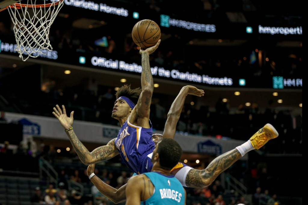 Phoenix Suns forward Kelly Oubre Jr. (3) shoots over Charlotte Hornets forward Miles Bridges in the first half of an NBA basketball game in Charlotte,...