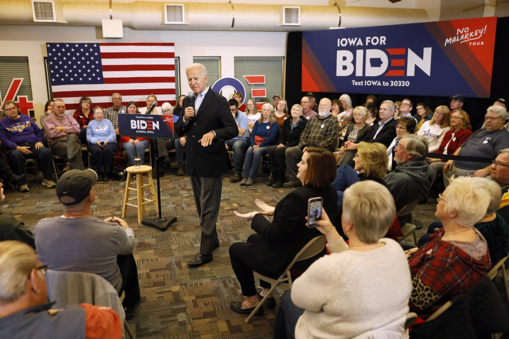 Democratic presidential candidate former U.S. Vice President Joe Biden speaks to local residents during a bus tour stop at Water's Edge Nature Center,...