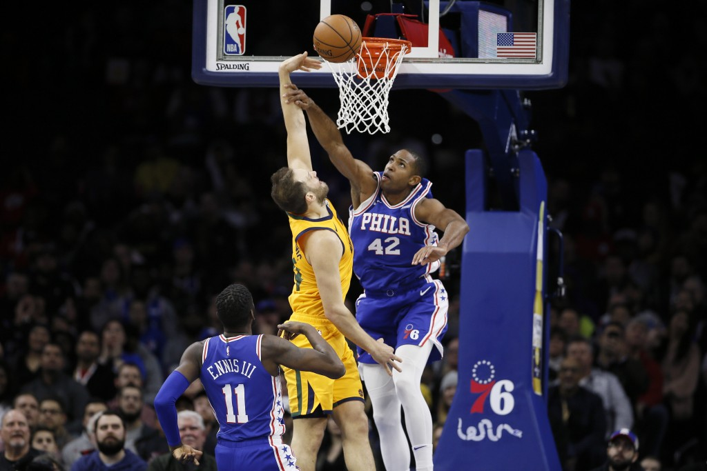 Philadelphia 76ers' Al Horford, right, blocks a shot by Utah Jazz's Bojan Bogdanovic, center, as 76ers' James Ennis III looks on during the first half...
