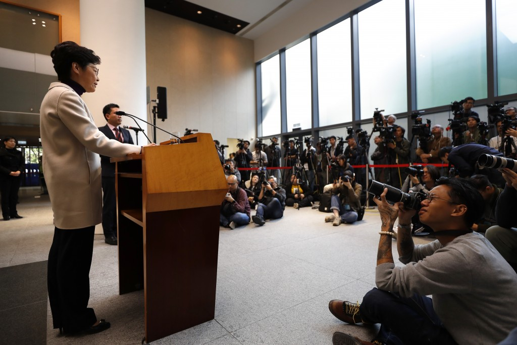 Hong Kong Chief Executive Carrie Lam speaks during a press conference at the Legislative Council in Hong Kong, Tuesday, Dec. 3, 2019. (AP Photo/Vincen...