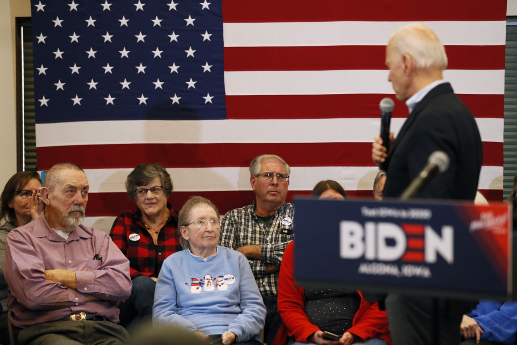 Audience members listen to Democratic presidential candidate former U.S. Vice President Joe Biden speak during a bus tour stop at Water's Edge Nature ...