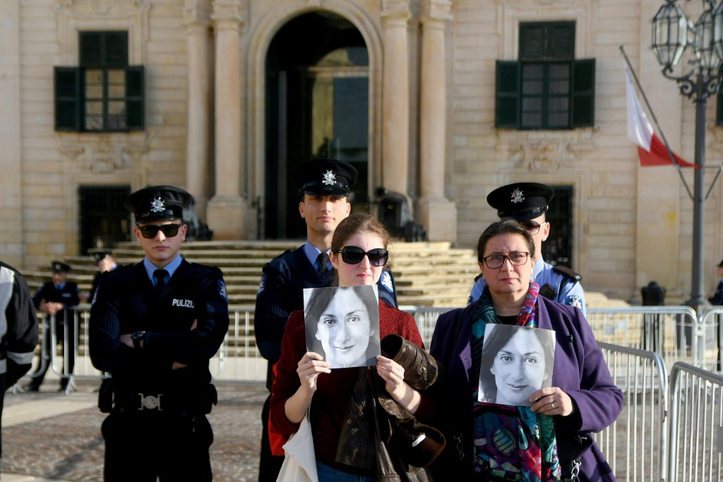 Daphne Caruana Galizia's Sister Mandy Mallia, right, protests outside the office of the Prime Minister at Castille, in Valletta, Malta, Tuesday, Dec. ...