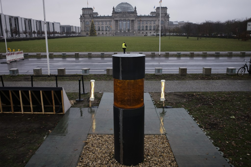 "This Monday, Dec. 2, 2019 photo shows an oversized urn placed by the artist group 'Center for Political Beauty"" in front of German parliament building..."