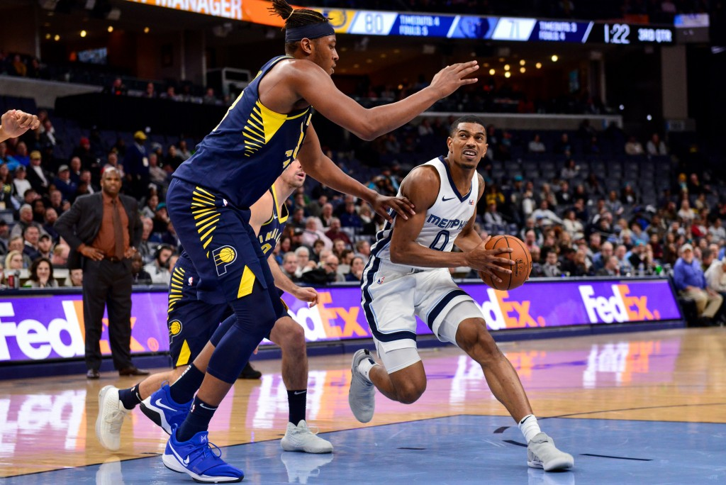 Memphis Grizzlies guard De'Anthony Melton (0) handles the ball against Indiana Pacers center Myles Turner in the second half of an NBA basketball game...