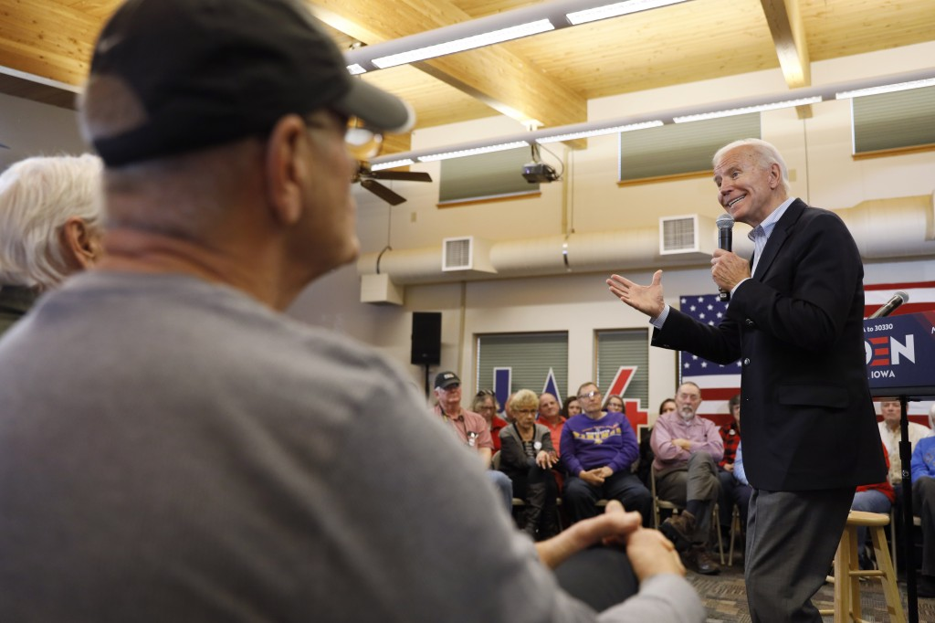 Democratic presidential candidate former Vice President Joe Biden speaks to local residents during a bus tour stop at Water's Edge Nature Center, Mond...