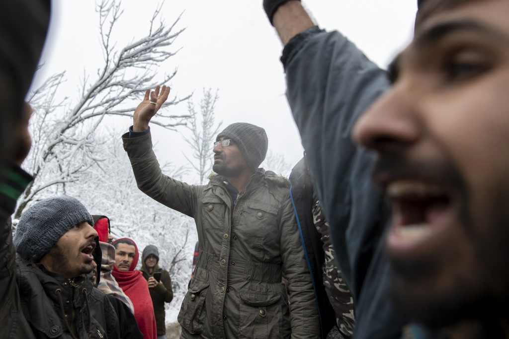 Migrants chant as they gather in protest of conditions at the Vucjak refugee camp outside Bihac, northwestern Bosnia, Tuesday, Dec. 3, 2019. Despite c...