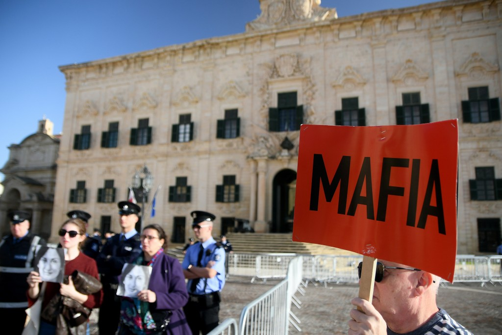 People protest outside the office of the Prime Minister at Castille, in Valletta, Malta, Tuesday, Dec. 3, 2019, as a delegation od European Union lawm...