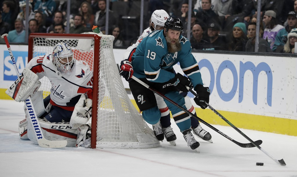 San Jose Sharks' Joe Thornton (19) looks for a shot against Washington Capitals goalie Braden Holtby, left, in the first period of an NHL hockey game ...