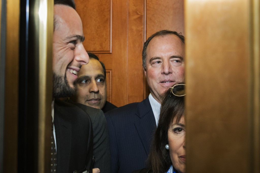 House Intelligence Committee Chairman Adam Schiff, D-Calif., back right, gets in the elevator with other lawmakers on Capitol Hill in Washington, Tues...