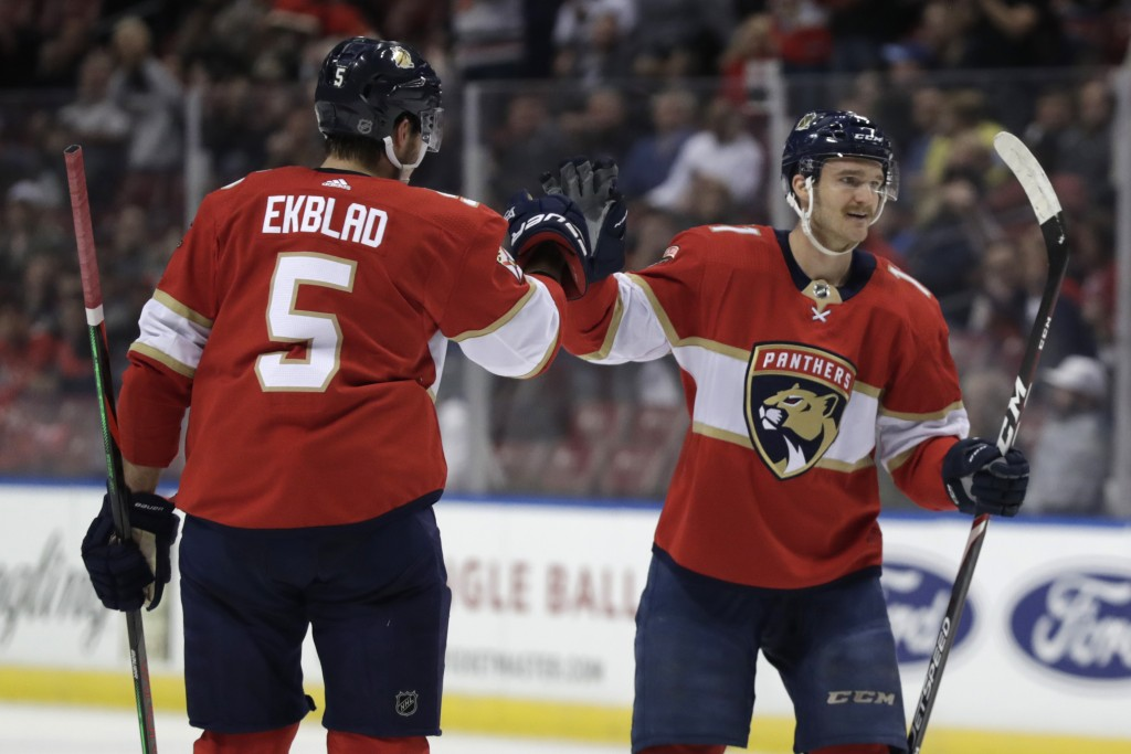 Florida Panthers center Jonathan Huberdeau, right, celebrates with defenseman Aaron Ekblad (5) after scoring a goal during the first period of an NHL ...