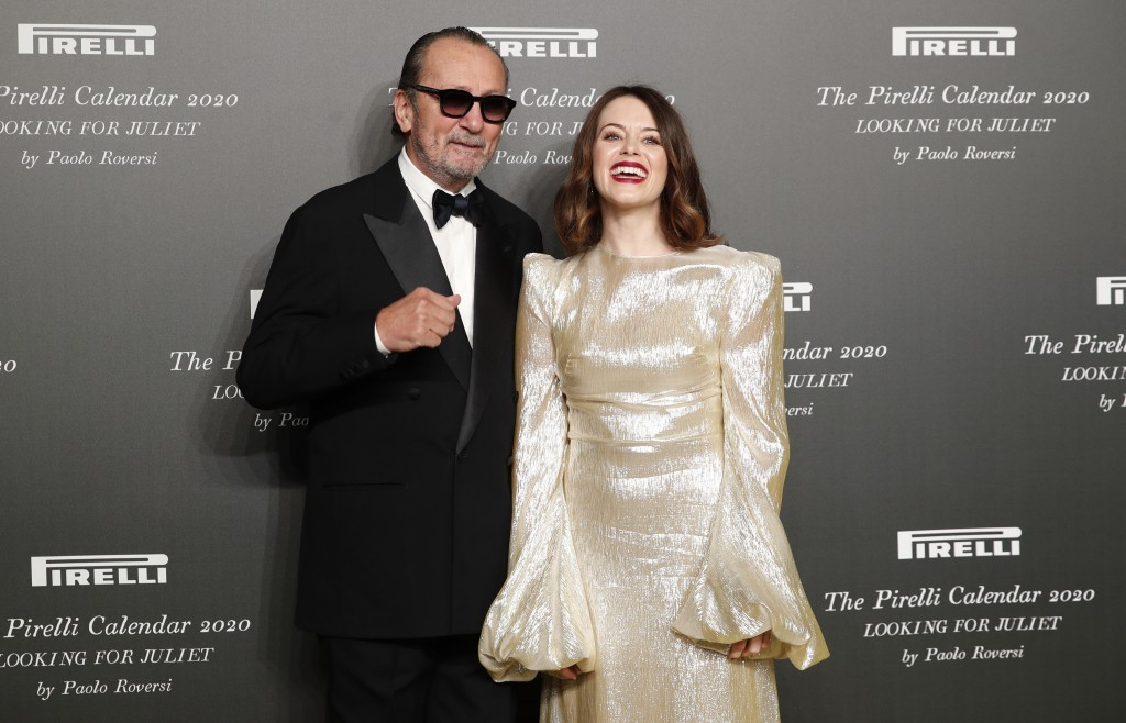 British actress Claire Foy, right, poses with Italian photographer Paolo Roversi, at the 2020 Pirelli Calendar event in Verona, Italy, Tuesday, Dec. 3...