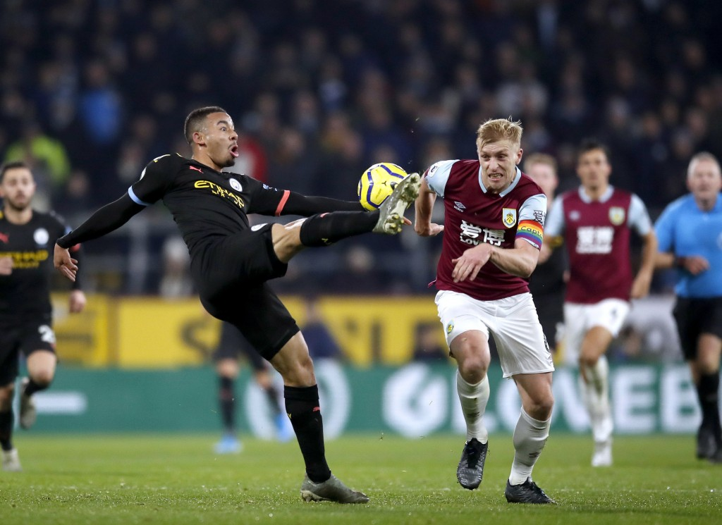 Manchester City's Gabriel Jesus, left, and Burnley's Ben Mee in action during their Premier League soccer match at Turf Moor in Burnley, England, Tues...