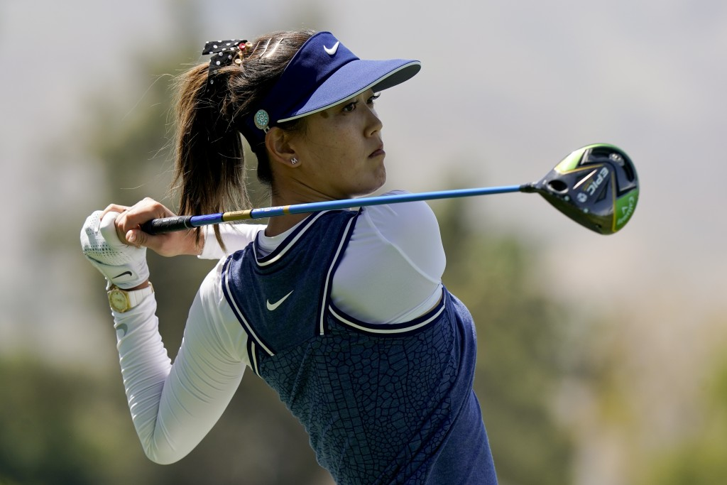 FILE - In this April 5, 2019, file photo, Michelle Wie watches her tee shot on the 118th hole during the second round of the LPGA Tour ANA Inspiration...