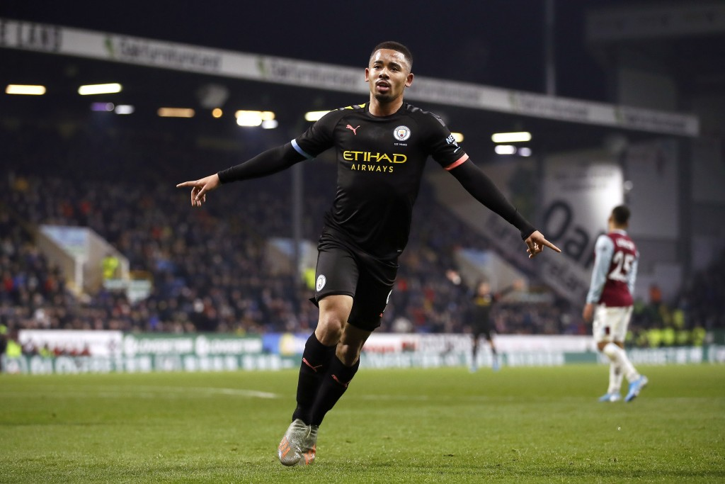Manchester City's Gabriel Jesus, right, celebrates scoring his sides first goal of the game against Burnley, during their Premier League soccer match ...