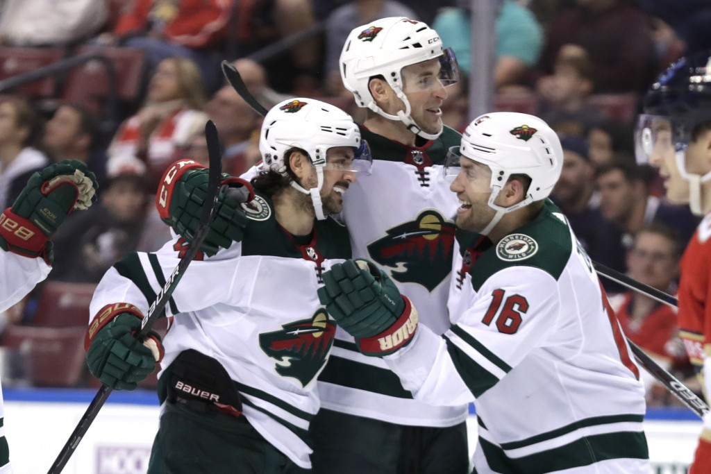 Minnesota Wild center Mats Zuccarello (36) celebrates with left wing Jason Zucker (16) after scoring a goal during the second period of an NHL hockey ...