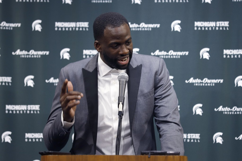 Former Michigan State and current Golden State Warriors player Draymond Green talks to reporters before an NCAA college basketball game between Michig...