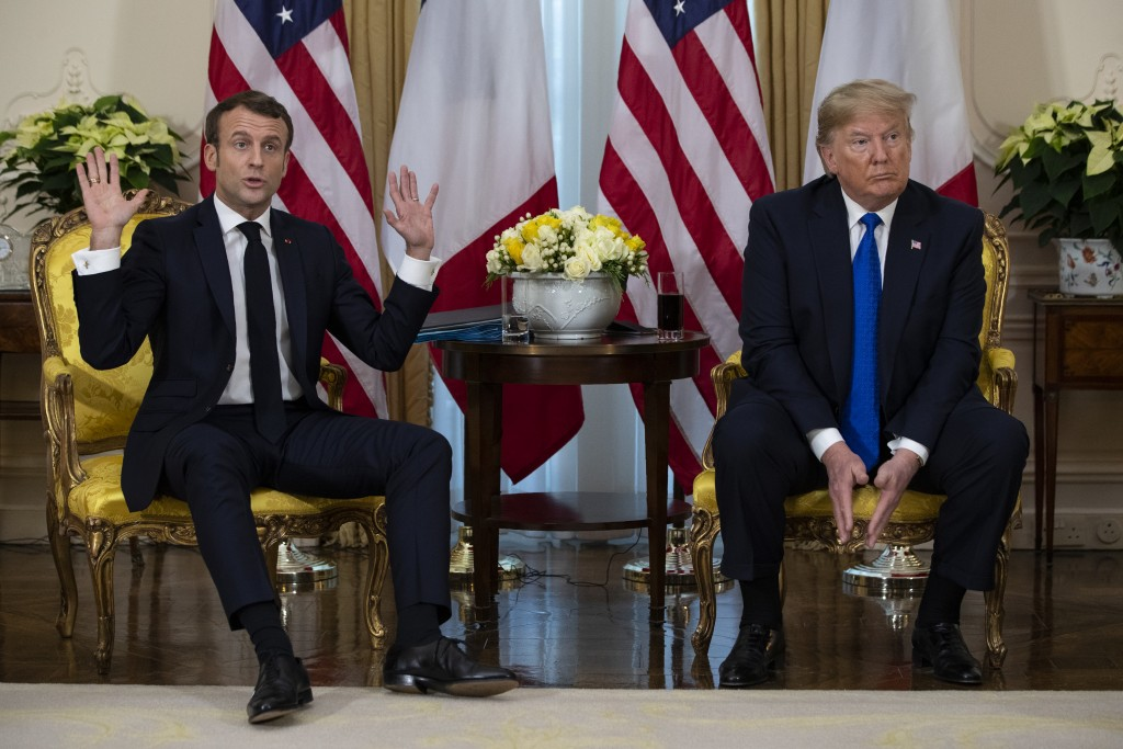 President Donald Trump listens as French President Emmanuel Macron speaks during a meeting at Winfield House during the NATO summit, Tuesday, Dec. 3, ...