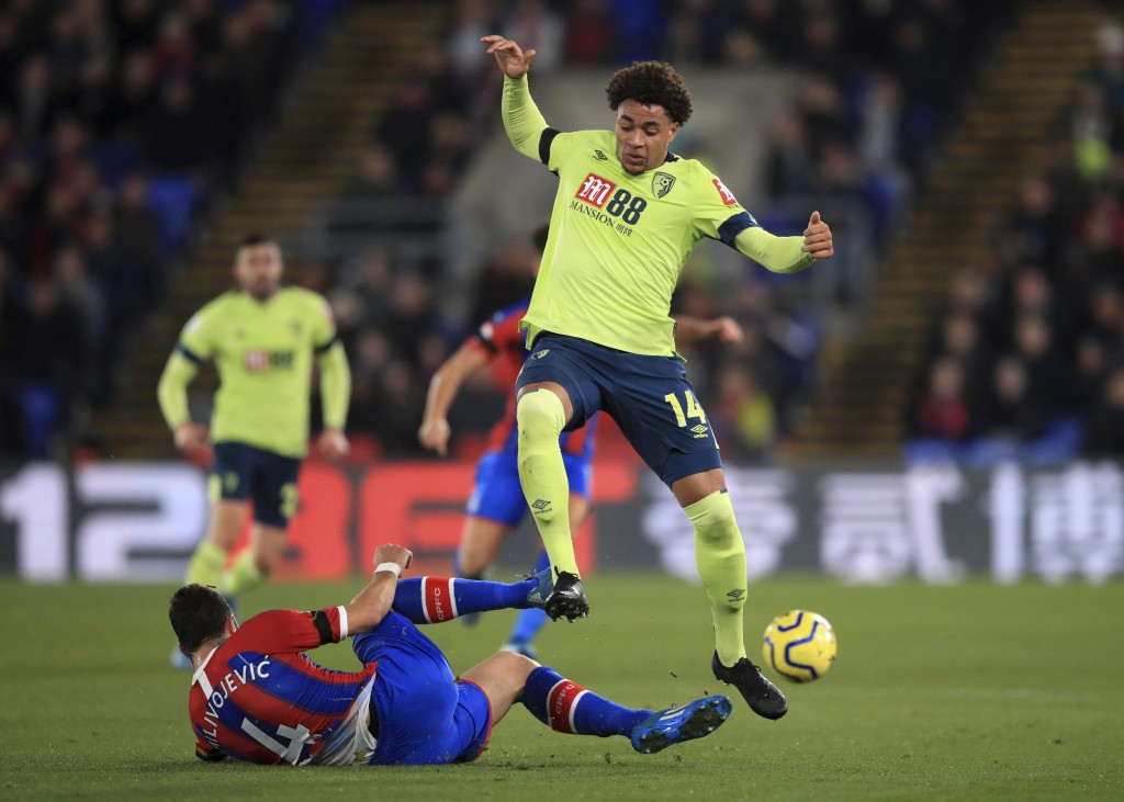 Crystal Palace's Luka Milivojevic, left, tackles Bournemouth's Arnaut Danjuma during their English Premier League soccer match at Selhurst Park in Lon...