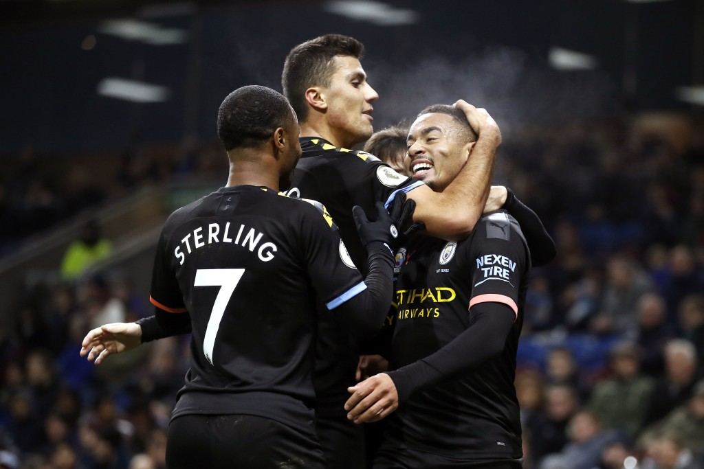 Manchester City's Gabriel Jesus, right, celebrates scoring his sides first goal of the game against Burnley, with teammates during their Premier Leagu...