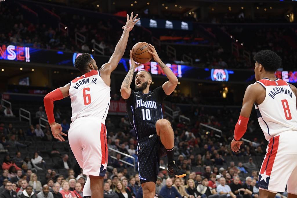 Orlando Magic guard Evan Fournier (10) goes to the basket between Washington Wizards guard Troy Brown Jr. (6) and forward Rui Hachimura (8) during the...