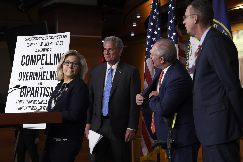 House Minority Leader Kevin McCarthy of Calif., second from left, is joined by Rep. Liz Cheney, R-Wy., left, House Minority Whip Steve Scalise, R-La.,...