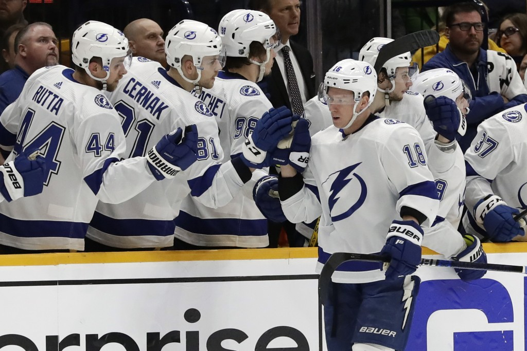 Tampa Bay Lightning left wing Ondrej Palat (18), of the Czech Republic, is congratulated after scoring a goal against the Nashville Predators in the s...