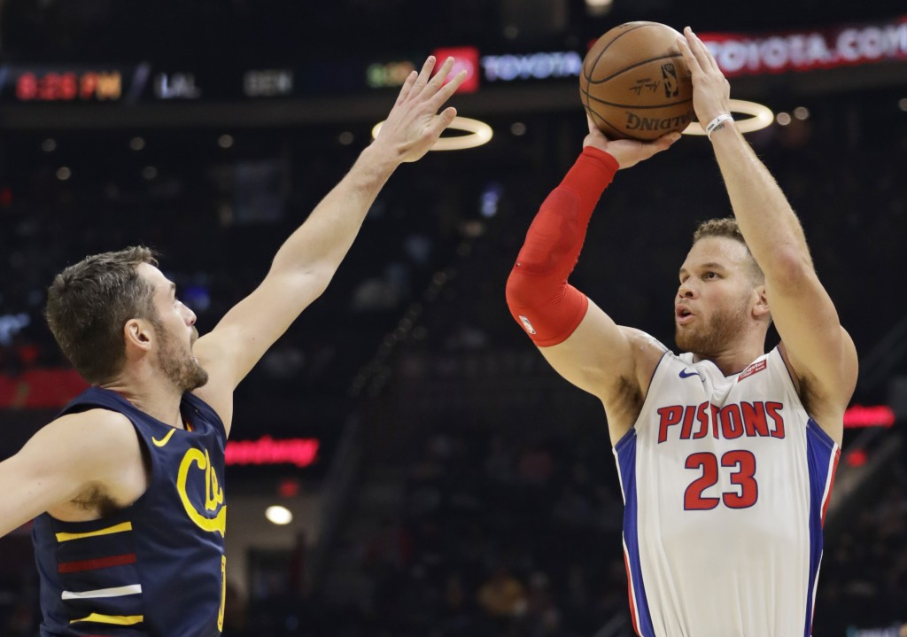 Detroit Pistons' Blake Griffin (23) shoots over Cleveland Cavaliers' Kevin Love (0) in the second half of an NBA basketball game, Tuesday, Dec. 3, 201...