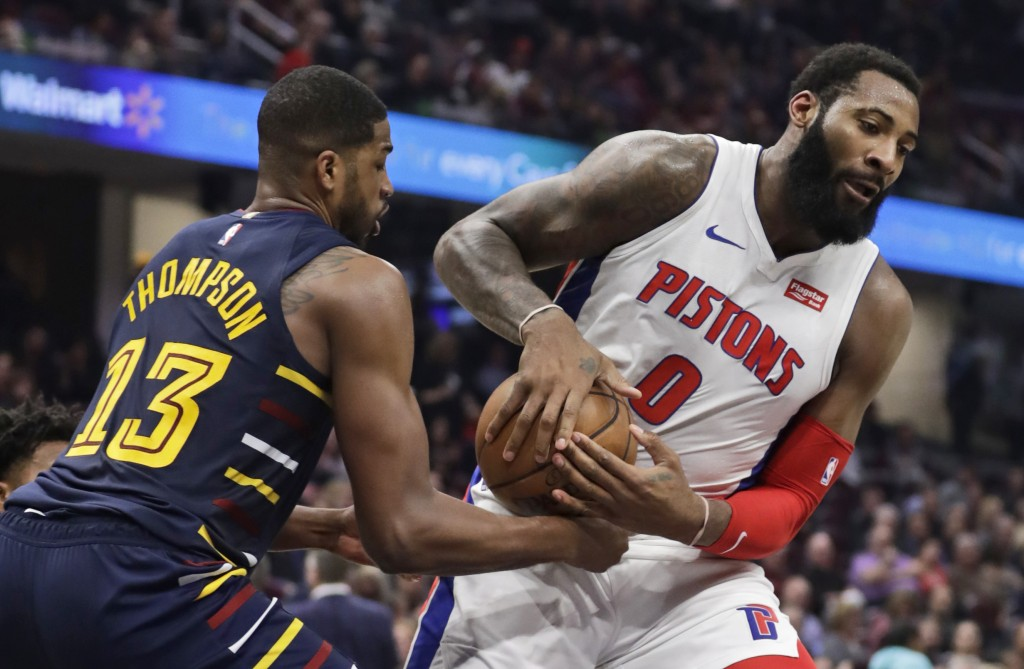 Detroit Pistons' Andre Drummond (0) drives past Cleveland Cavaliers' Tristan Thompson (13) in the second half of an NBA basketball game, Tuesday, Dec....