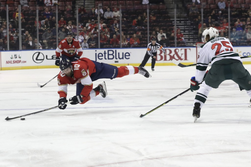 Florida Panthers right wing Brett Connolly (10) is found by Minnesota Wild defenseman Jonas Brodin (25) during the first period of an NHL hockey game,...